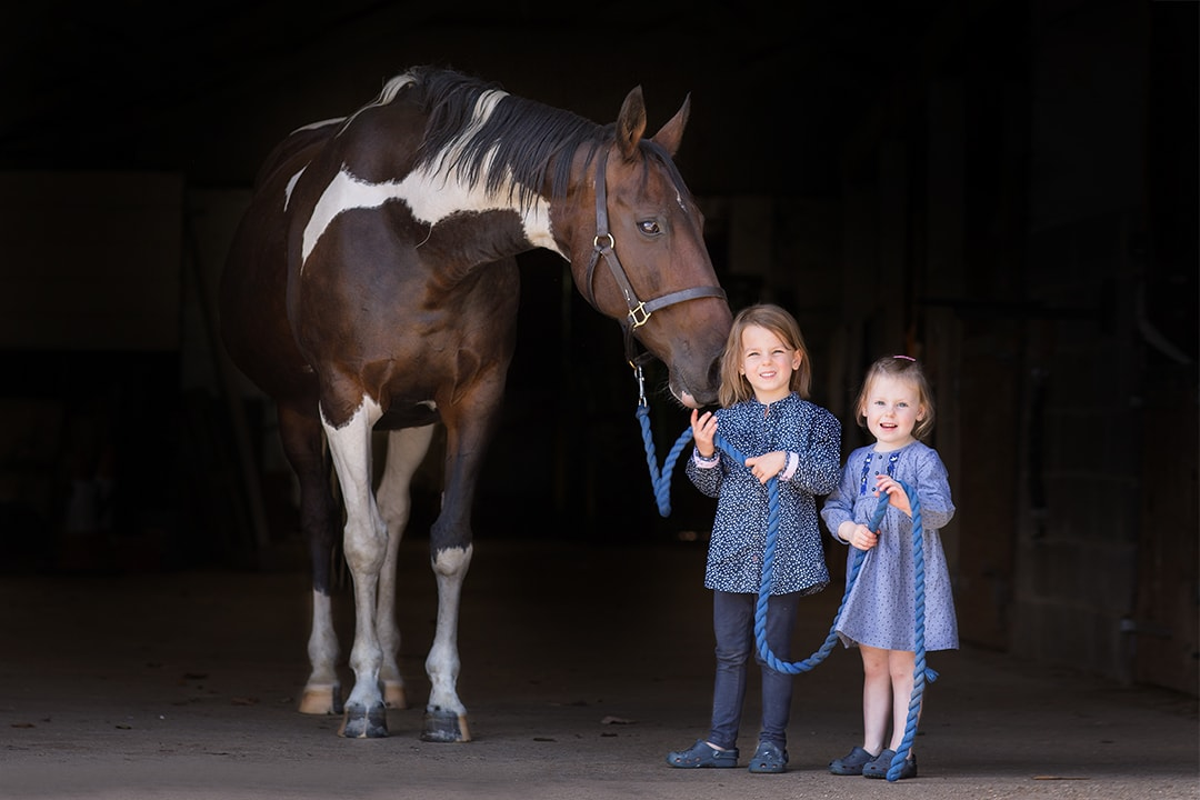 sisters with their horse