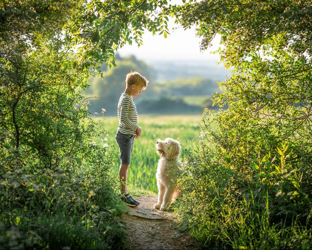 A boy with his pet dog enjoying a photoshoot in Newmarket