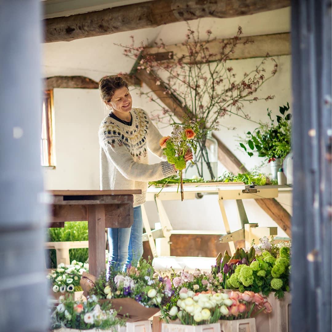 florist Amelia Cornish photographed in her studio near Saffron walden during a Personal branding photoshoot