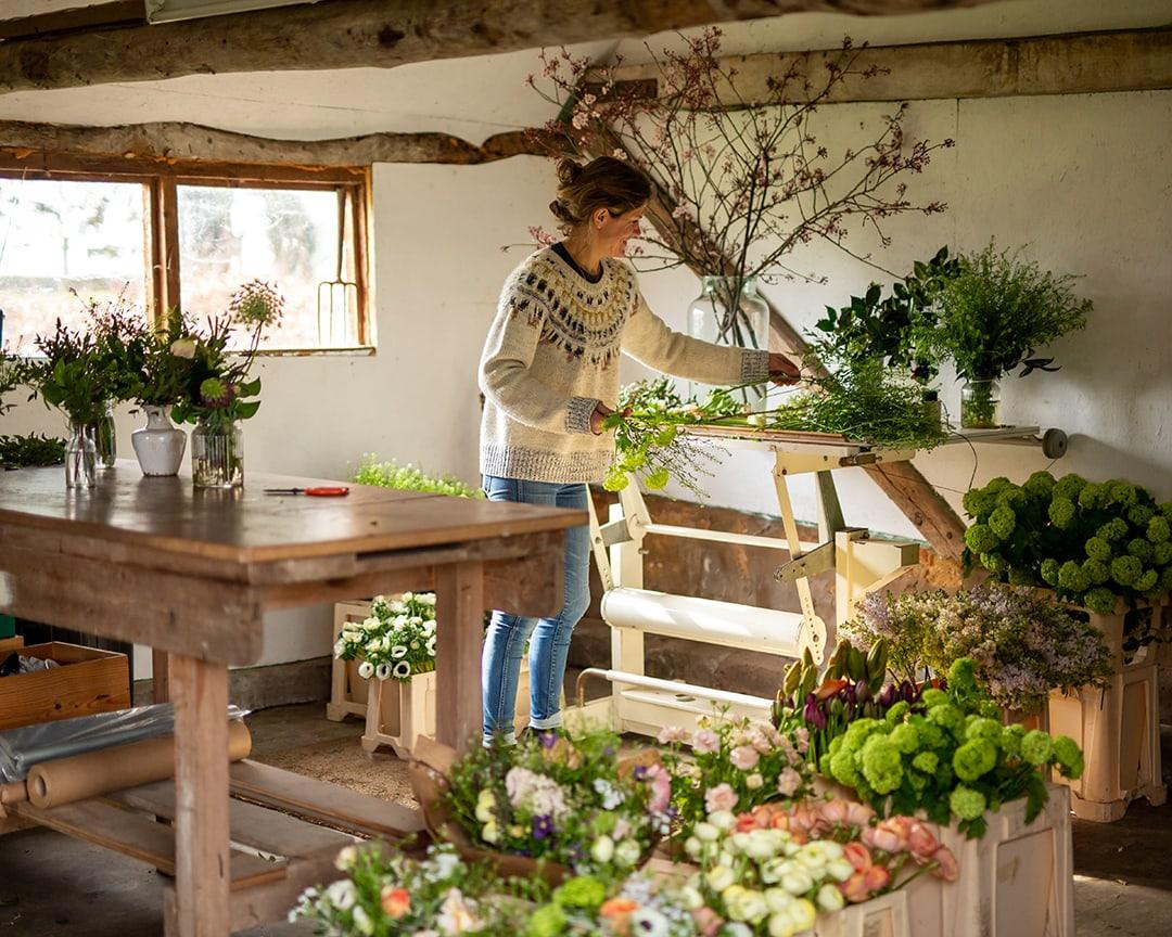 cambridge florist Amelia Cornish, photographed in her studio during a personal branding photoshoot