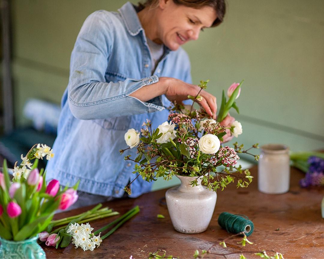 Cambridge florist, Amelia Cornish, working in her studio during a personal branding photoshoot