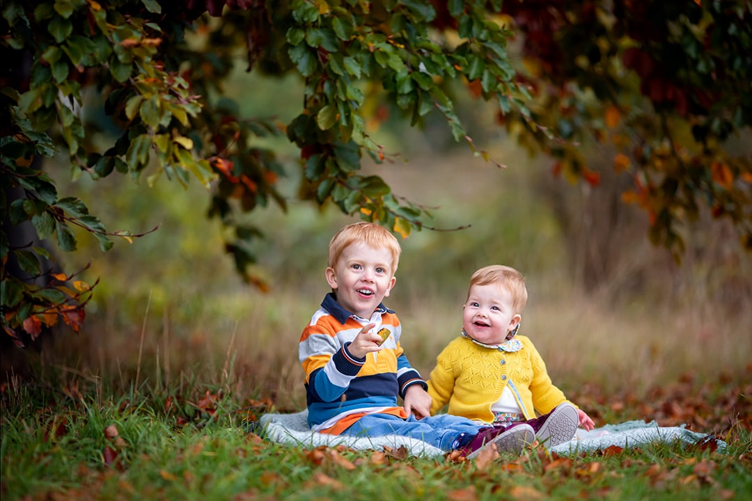 children photographed in the Autumn leaves in Cambridgeshire