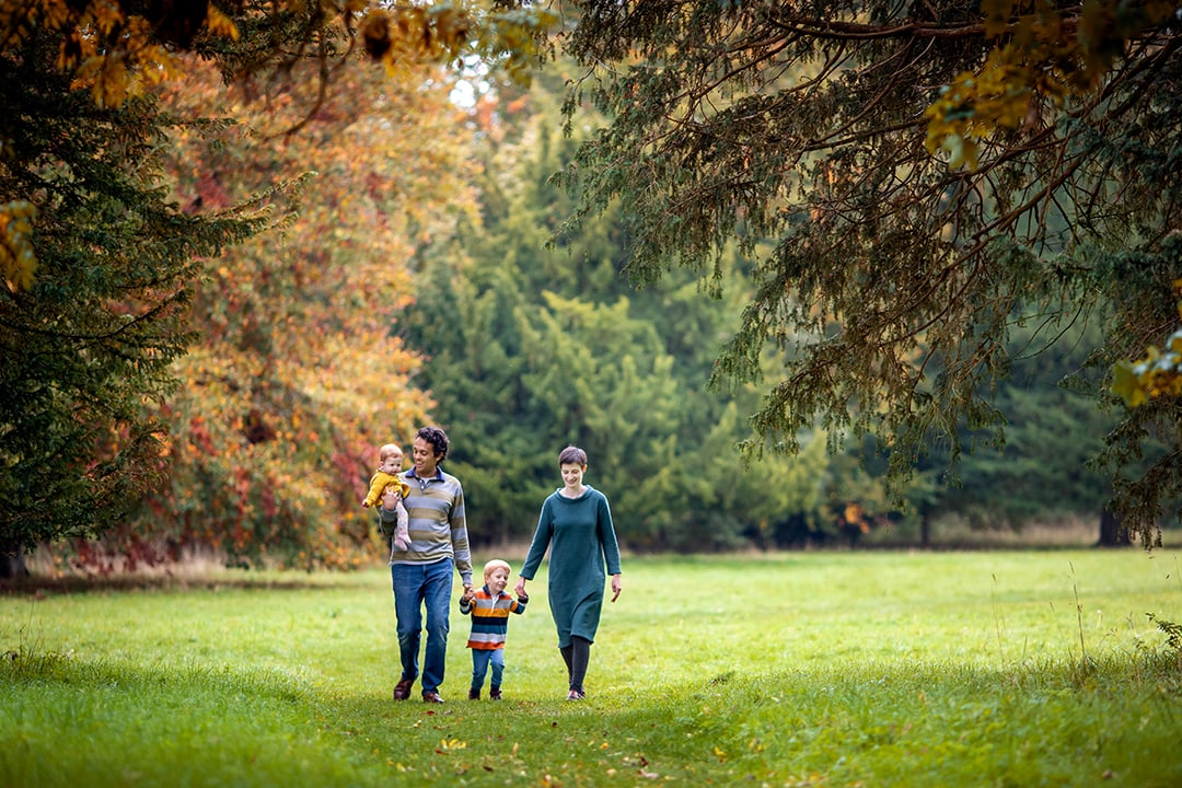 family walking through wandlebury country park during a mini shoot