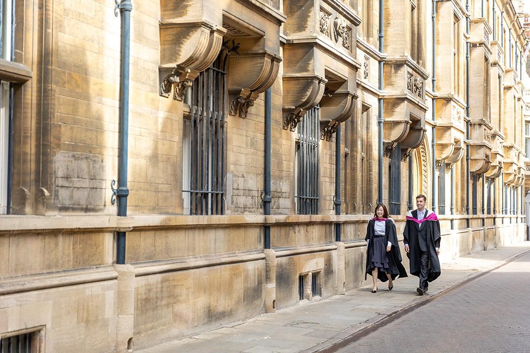 Graduating students on Trinity street Cambridge during a photoshoot