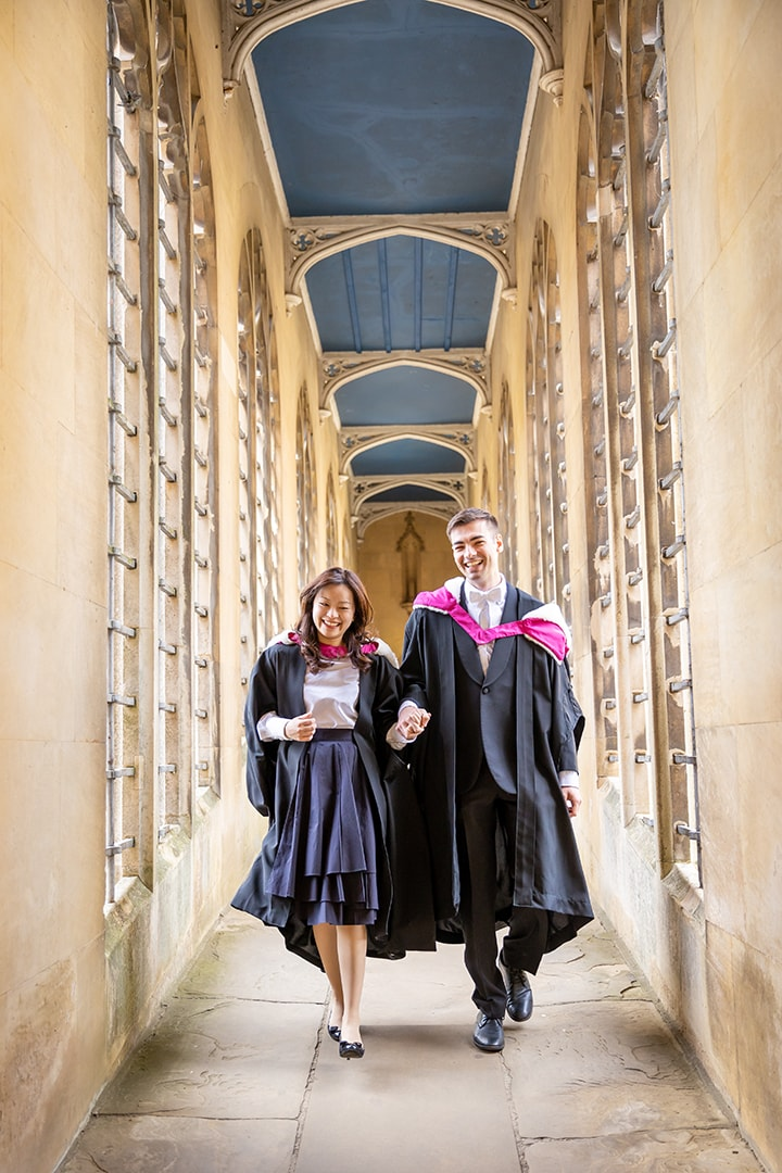 Students walking through the Bridge of Sighs at St Johns College Cambridge