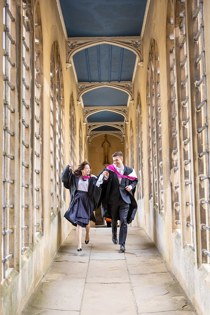 Cambridge students inside the Bridge of Sighs at St Johns College
